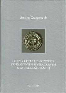 Okrągłe fibule tarczowate z ornamentem wytłaczanym w grupie olsztyńskiej